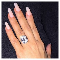 The secret to an enviable engagement ring photo isn't about the background or even the rock itself, at least not entirely: it's about having the perfect polish color or manicure to go with your sparkler. Try doing it like Kim!
