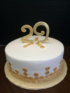 Gold and white cakes The Cake Box Baytown Tx