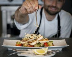 Pan seared fish fillet as per catch of the day, served with Naxos potato salad and oregano at Grace Santorini.