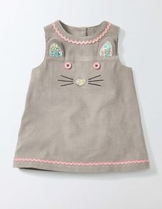 Party or playdate – this pinny suits whatever your baby has planned. The rickrack trim and embroidered cat face are ready for fun. With buttons down the back it's easy to take off and put on, so your little one can return to their busy schedule.