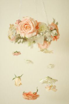 Flower mobile with pink, ivory and peach blossoms for baby nursery or flower chandelier for events. From Love Sparkle Pretty http://lovesparklepretty.com/shop/ethereal-flower-chandelier