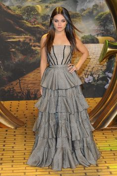 Mila Kunis attends the European Premiere of Oz: The Great and Powerful at Empire Leicester Square in London, England. #fashion #style #celebrity #dress #looks #redcarpet