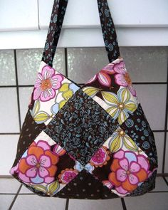 This patchwork bag is made using charm squares and has a great shape due to the way that fabric squares are sewn together.