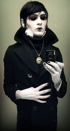 Cool Barnabus Collins makeup<------ that is Ghost from motionless in white, he dresses as different characters all the time on stage.