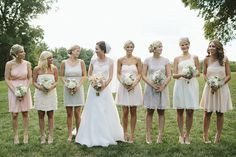 Romantic blush pink, peach and gold wedding; Love that all the bridesmaids are wearing different dresses.