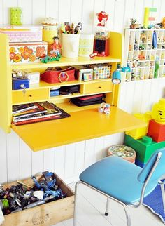 yellow kids desk space -- fold-down desk for inside playhouse Kids Desk Space, Kid Desk, Lego Desk, Craft Space, Fold Out Desk, Desk Flip, Folding Desk, Wall Mounted Desk, Wall Desk