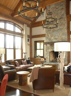Natural Elements... Stone, wood, and leather.  I love stone fireplace, exposed beams (could be whitewashed?) and leather (easy to clean)... The rustic lightening is a nice touch as is the soft but durable jute rug.