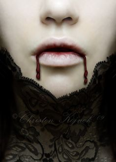 I wiped the blood away that was trickling from her mouth...