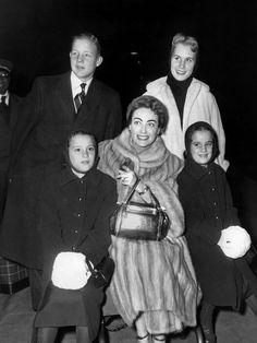 Joan Crawford (center), having completed work on Autumn Leaves (1956), posing with her adopted children, top, from left: Christopher Crawford, Christina Crawford, bottom, from left: Cynthia Crawford, Cathy Crawford.