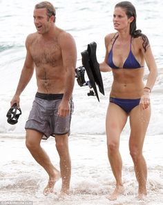 No wonder he's smiling: Scott Caan was spotted filming scenes for Hawaii Five-O with a bikini-clad beauty this weekend