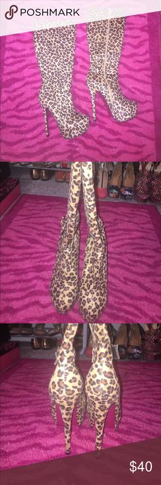 """Brand New Sz 8 Cheetah/ Leopard boots Brand new, only tried on, Sz 8 suede(ish) Cheetah/ Leopard under the knee boots. Awesome """"red bottom"""" ♥️ AMI Clubwear Shoes Heeled Boots"""