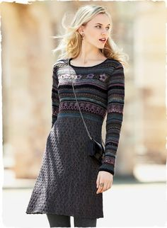 A whimsical art knit, #handcrocheted in a panoply of stitches at the fitted bodice and sleeves. In heathery hues of berry, orchid, plum, teal and olive, it flares from high waist to a  honeycomb-textured, knit A-line skirt. Baby alpaca, alpaca, wool and pima,
