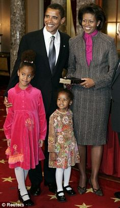 The Obamas at a mock swearing-in for Senator Barack Obama, at the U.S Capitol. (Sasha Obama is 3.)