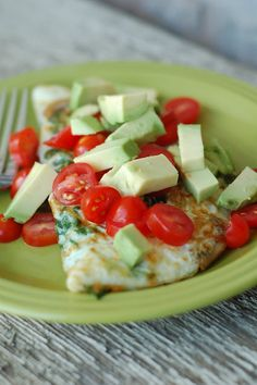 egg white omelet with spinach, mushrooms, cheese, tomato and avocado.