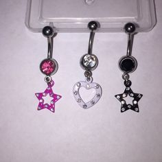 Set of 3 dangle belly button rings Set of three steel dangle belly button rings- pink star, white heart, and black star, all with matching color crystals and embedded gems. Jewelry