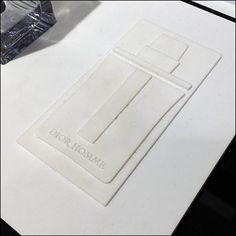 If there could be Bas-Relief for bottles of Cologne, this Dior® Homme embossed design mightexemplify it. The relief is barely seen at a distance but offers a sophisticated, three-dimensional touch...
