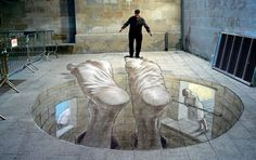 Argentinean 3D street artist Eduardo Relero : A visitor stands on a 3D mural called, 'Insesatez', in Lleida, Spain