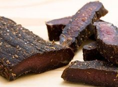 Biltong is an all-time favorite South African snack. This biltong recipe will let you experience what the fuss is all about.It might be a little work to make biltong, but it is well worth the effor. Read Recipe by mrydms A Food, Good Food, Food And Drink, Charcuterie, Jerky Recipes, Meat Recipes, Tagine Recipes, Chicken Recipes, Biltong