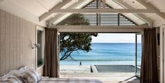 Set on a quintessential New Zealand beach this house is adjacent to the shoreline, allowing for uninterrupted views and a simple flow through the lawn to the sand. The dwelling consists of two simple gable forms pushed together. These are clad in Cedar weatherboards and battens. Contrasting materials are used throughout, strengthened by insitu concrete, creating a relaxed informal environment.