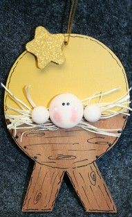 Baby Jesus in a manger craft/ornament.