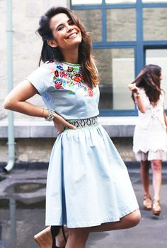 Sara Escudero of Collage Vintage in an embroidered denim dress + statement jewelry