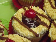 Toasted Coconut cupcake with a cherry on top! Get one at Downtown Stroudsburg's local bakery, Kitchen Chemistry.