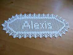 Description Up for sale is a new, handmade custom filet crochet name doily with YOUR NAME! This doily includes up to 5 letters. If you need a longer name, extra letters will be $4.00 each.  These doilies make great gifts for Christmas, weddings, anniversaries, birthdays, baby showers or any other special occasion! They look beautiful anywhere in your home!  Available in white or ecru. Made from 100% cotton crochet thread.   Please allow 6 days for your doily to be completed once I receive…