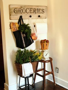 Create Your Own Vintage Sign | HGTV    Add style and function to your kitchen with a vintage-inspired sign made from plywood, paint and vintage knobs. Its ideal for storing reusable bags and baskets for farmers market and garden goodies.