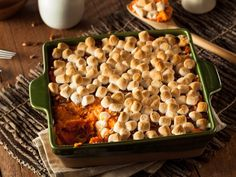 """A Thanksgiving classic with a nineties twist. There are marshmallows and brown sugar to keep the youngsters happy, and """"big kids"""" will like the addition of almonds and spices."""