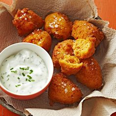 Sweet Potato Fritters with Yogurt-Chive Dipping Sauce 21/2C sweet potato, peeled&cut,1 egg,1/4Cpacked BRsugar,2tbsbutter,1Cflour,1/3Cfine dry breadcrumbs,2tsp bakingpowder,1/4tsp salt,Vege oil Cook potatoes until tender. Drain&cool slightly.In a processor combine sweet potatoes,egg, Brsugar&butter,until smooth.In a bowl stir flour,bread crumbs,baking powder&salt.Add flour mixture to potato mixture.Cover&process,smooth deep-fry 1tbs of fritter at a time.Fry until golden.Remove&drain on paper.