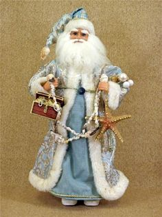 Blue Sea Shell Santa Claus Figurine Karen Didion - This would be a great piece for a sea or aquatic theme Christmas decor.
