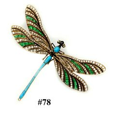Rose-cut  diamond, caliber-cut emerald, caliber-cut turquoise, enamel and gold dragonfly  brooch.  French.  This is an exquisite  brooch with delicate wings of small diamonds with calibre cut turquoises giving  the wings an ethereal look.  The rest of  the body is of buff-cut turquoises in a thin line.  The brooch is so realistic that it looks like  a real dragonfly landed on the wearer.   French hallmarks and makers mark.