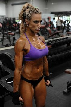 """It annoys me SO MUCH when people call this """"gross."""" She's beautiful and obviously very dedicated. People just bash women with muscles because they aren't motivated enough to get up off the couch themselves."""