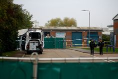Police officers are seen at the scene where bodies were discovered in a lorry container, in Grays, Essex, Britain October 23, 2019.  REUTERS/Hannah McKay via @AOL_Lifestyle