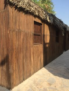 Palm tree construction Visit Dubai, Architecture Old, Old And New, Palm Trees, Garage Doors, Construction, Cabin, House Styles, Outdoor Decor