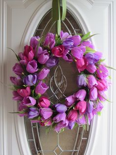 A beautiful tulip wreath with shades of pink and purple silk tulips on a grapevine wreath. Perfect for any door for spring or summer. The dimensions are about 20 inches in diameter and 4 1/2 or 5 inches deep. Thank you for visiting.