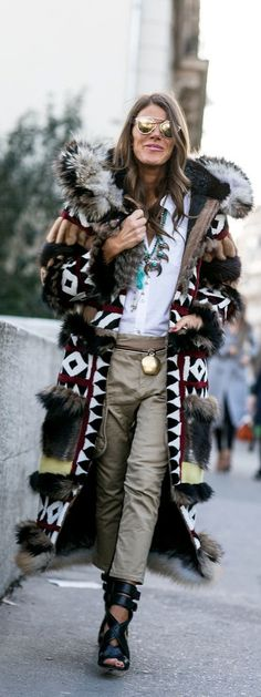 Paris Fashion Week Street Style: Anna Dello Russo wearing safari pants and a floor length furry jacket plus sandals