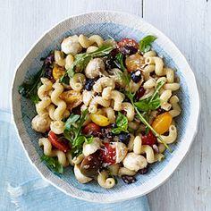 Mozzarella balls, cherry tomatoes, and fresh basil make up this fresh Caprese Pasta Salad.