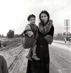 "February 1939. ""On U.S. 99 near Brawley, Imperial County, California. Homeless mother and youngest child of seven walking the highway from Phoenix, Arizona, where they picked cotton. Bound for San Diego, where the father hopes to get on relief 'because he once lived there.'"" by Dorothea Lange"