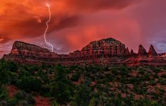 https://flic.kr/p/VDrMK5 | Lucky Strike | A sunset storm over the Twin Buttes and Two Nuns (right) near Sedona, Arizona. We've been getting some pretty wicked monsoon driven storms over the last week and this one took the cake photographically! The batteries in my lightning trigger died just before the sky went nuclear, but I still managed to catch this strike by taking repeated exposures as the lightning was coming fast and furious by this point.