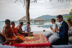 Monks conduct a traditional Khmer blessing ceremony for a western bride and groom at Song Saa Private Island - Cambodia's premier luxury resort.