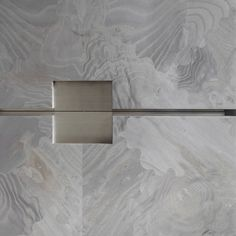 Bookmatched grey jigsaw-cut ash veneer and brushed stainless-steel