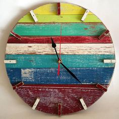 This retro beach house wall clock is handcrafted with recycled wood from old wooden boats and homes.  Featuring bright colors and a weathered finish, this clock hangs beautifully on any wall.