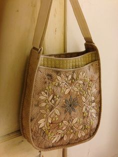 quilted and embroidered bag. This work looks antique with its muted tea colors.