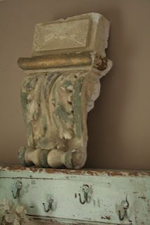 architectural piece on a rustic mantel front, soft muted greens