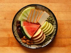Honeydew melon, sliced smoked tofu, pumpkin seeds, granny smith apple slices, gala apple slices, raw almonds, sayer dates, and sliced watermelon.