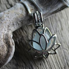BRAND NEW!  Stay calm and peaceful with my new lotus flower locket necklace! This one features one tiny soft blue piece of recycled glass, tumbled