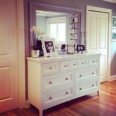 Dresser with mismatched mirror.