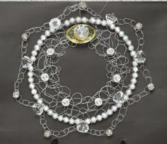 This pretty little thing I made from perls and wire. See more details from my blog www.kristallikimara.blogspot.com