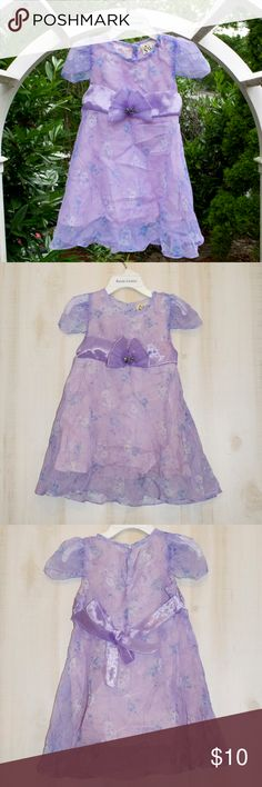 3/$20 Girls Purple Flower Print Dress This item is like new! No flaws.  Features: * Light purple with white and blue flowers * Has decorative silky tie in the back with a purple bow in front  Materials: * 100& Polyester  Measurements: * Size 4T * Length 20in * Waist 24in * Chest 22in  Ask any questions. No trades.  DEAL ALERT - Girls clothing 2/$15, 3/$20 Dresses